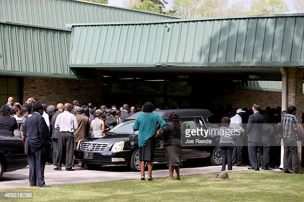 Mourners wait to enter the WORD Ministries Christian Center for the funeral of Walter Scott after he was fatally shot by a North Charleston police...