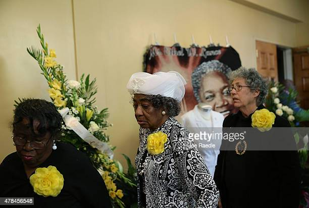 Mourners walk past a picture of Ethel Lance who was one of nine victims of a mass shooting at the Emanuel African Methodist Episcopal Church as they...