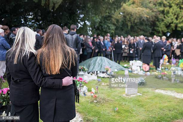 Mourners walk through the cemetery for the funeral of a baby girl who was found dead on a footpath earlier this year at Wolvercote Cemetery on...