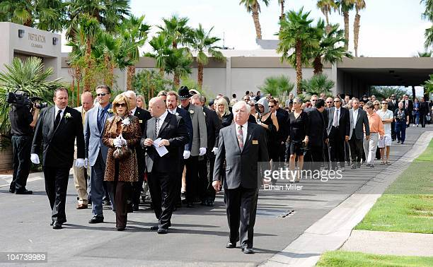 Mourners walk to the burial site for Tony Curtis during the actor's funeral at Palm Mortuary Cemetary October 4 2010 in Henderson Nevada Curtis died...