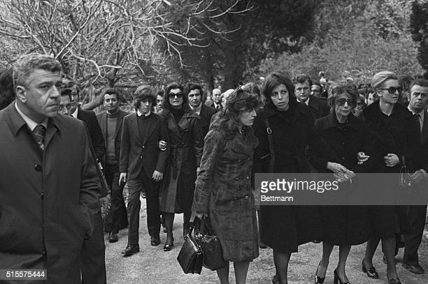 Mourners walk up a lane on Skorpios to the funeral services for shipping magnate Aristotle Onassis In the front row is his daughter Christina Onassis...