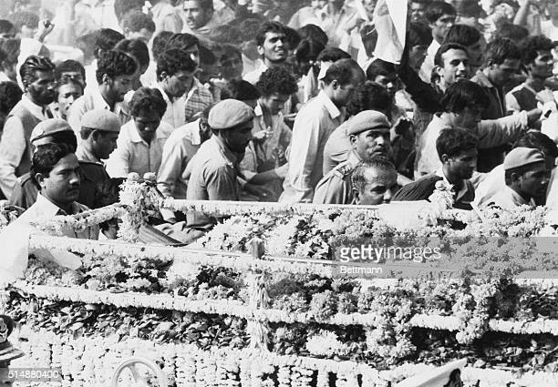 Mourners walk with the bier of Prime Minister Indira Gandhi on its way to cremation Gandhi was assassinated by two of her own bodyguards in 1984