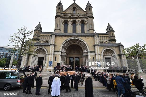 Mourners watch as the coffin of journalist Lyra McKee is taken out of the church after the funeral at St Anne's Cathedral on April 24 2019 in Belfast...