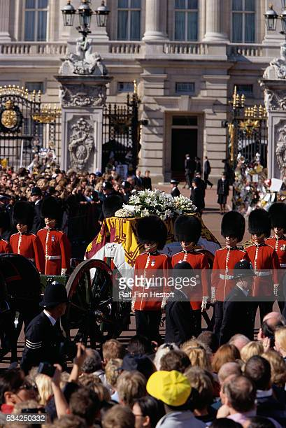 Mourners watch as the Queen's Life Guard escorts the coffin of Diana Princess of Wales outside Buckingham Palace during her funeral