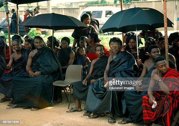 Mourners wearing traditional black adinkra' cloth at a funeral in Kumasi the capitol of the Ashanti Region of Ghana West Africa