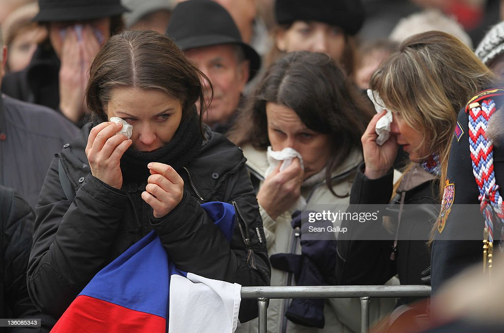 Mourners weep at the conclusion of the state funeral of former Czech President Vaclav Havel at St. Vitus Cathedral on December 23, 2011 in Prague, Czech Republic. International heads of state and thousands of mourners came to pay their last respects to the dissident playwright who led the Velvet Revolution that forced communist rule in Czechoslovakia to crumble in 1989, and died in the early morning of December 18 in his sleep at the age of 75.