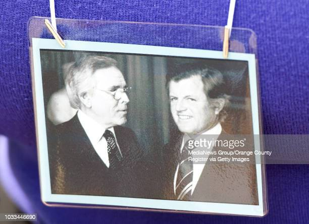 Mourners were given a photo memento of Robert H. Schuller during a public service for the Crystal Cathedral founder Monday. ///ADDITIONAL...