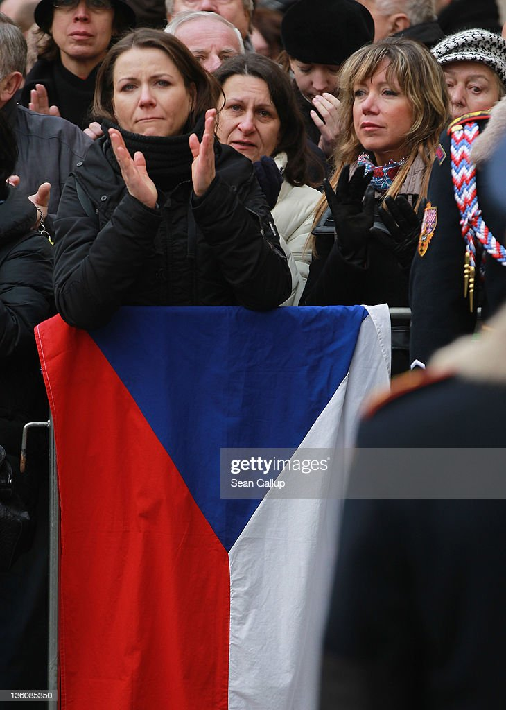 Mourners with a Czech flag applaude at the conclusion of the state funeral of former Czech President Vaclav Havel at St. Vitus Cathedral on December 23, 2011 in Prague, Czech Republic. International heads of state and thousands of mourners came to pay their last respects to the dissident playwright who led the Velvet Revolution that forced communist rule in Czechoslovakia to crumble in 1989, and died in the early morning of December 18 in his sleep at the age of 75.