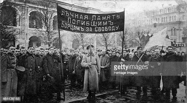 A mourning ceremony for victims of the February Revolution Russia 1917 The February Revolution led to the abdication of Tsar Nicholas II and the...