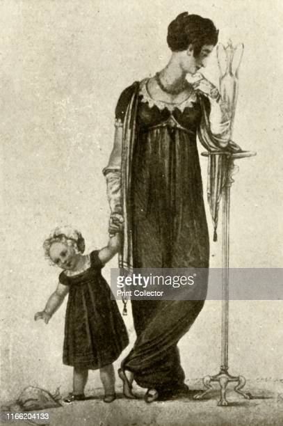 """Mourning dress of mother and child, of black cashmere with scarf drapery of crepe; child's cap of white mull with black ribbon' . From """"History of..."""