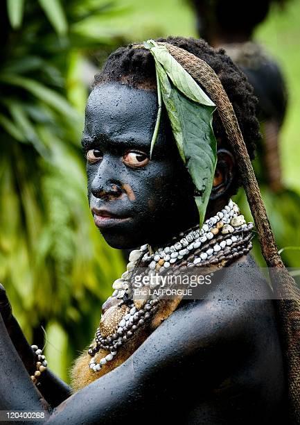Mourning Emira papu boy in Highlands in Papua New Guinea Emira people use sump oil to darken their skin