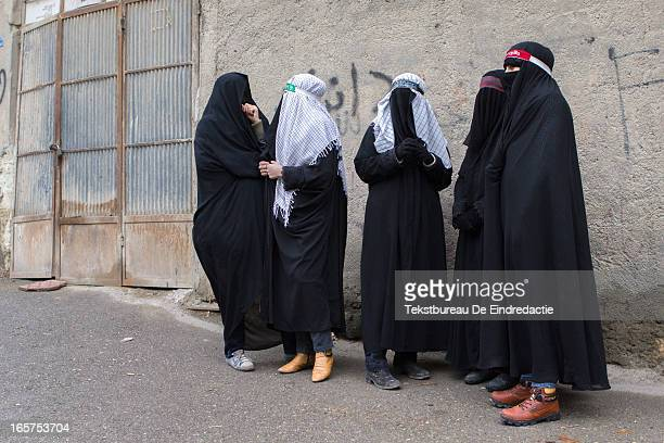 CONTENT] Mourning Iranian shi'a muslim women dressed in black early in the morning on the Day of Ashura on which shi'a muslims commemorate the...