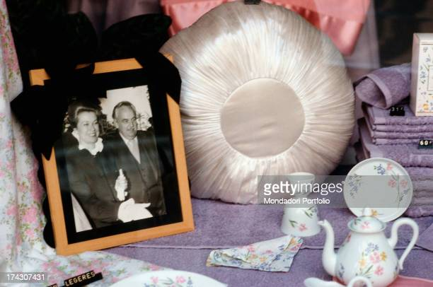 Mourning photography of Ranieri III and Grace of Monaco exposed in a shop window among items in the occasion of the funeral of the Princess beside...