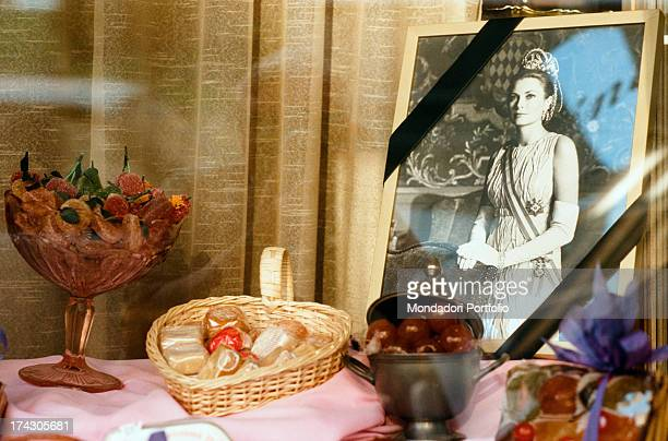 A mourning photography of the Princess Grace exposed in a sweetness shop window Montecarlo September 18th 1982