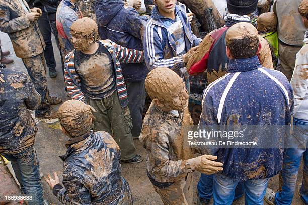 Mourning shi'a muslim boys and men, covered in mud, on the Day of Ashura, on which shi'a muslims commemorate the martyrdom of Husayn ibn Ali,...