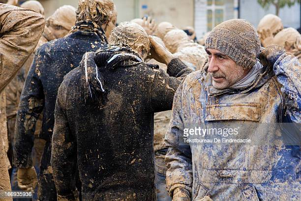 CONTENT] Mourning shi'a muslim men covered in mud on the Day of Ashura on which shi'a muslims commemorate the martyrdom of Husayn ibn Ali grandson of...