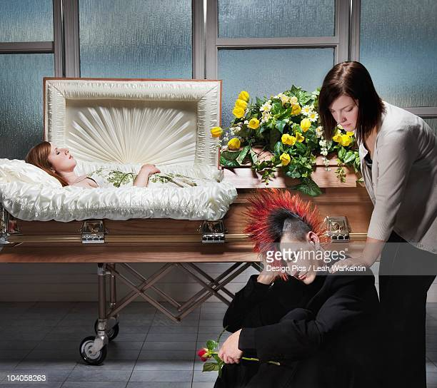 mourning the death of a loved one - coffin stock pictures, royalty-free photos & images