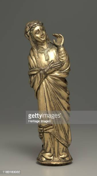 Mourning Virgin early 1400s These small statuettes would have originally flanked a crucifix as suggested by this arrangement According to the Gospels...