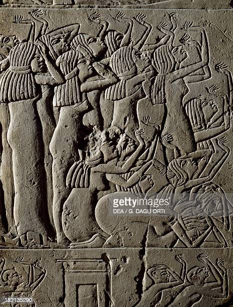 Mourning women performing a funeral dance detail from decorative relief in the Tomb of Horemheb limestone stele Saqqara Egyptian Civilisation New...