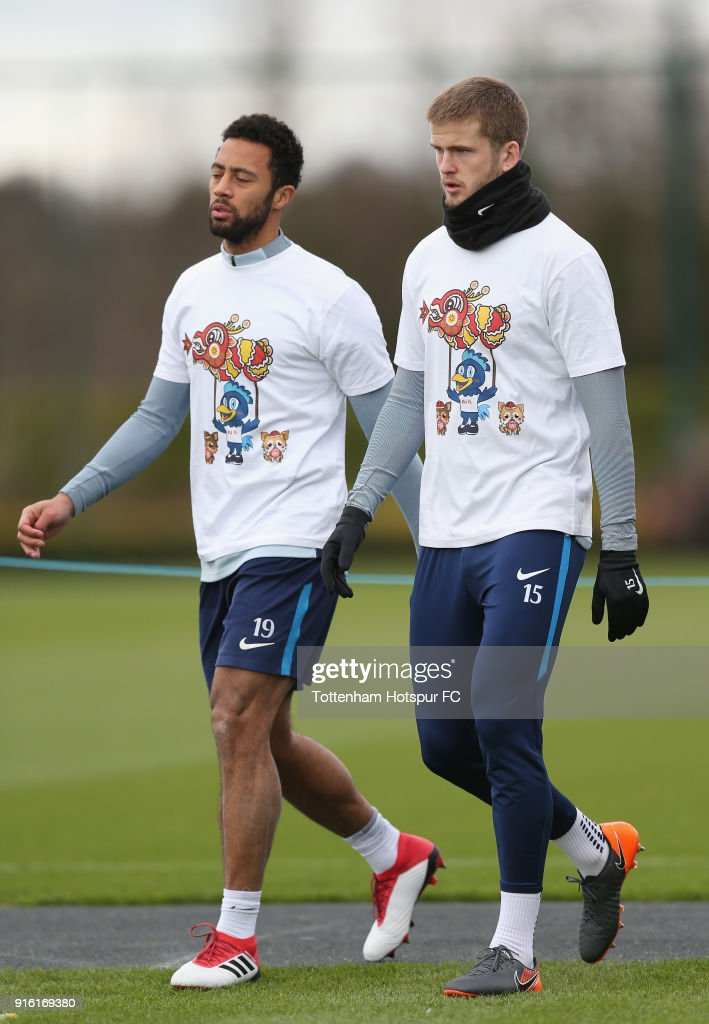 Mousa Dembele and Eric Dier of Tottenham Hotspur train in a Chinese New Year t-shirt ahead of the north london derby during the Tottenham Hotspur training session at Tottenham Hotspur Training Centre on February 9, 2018 in Enfield, England.