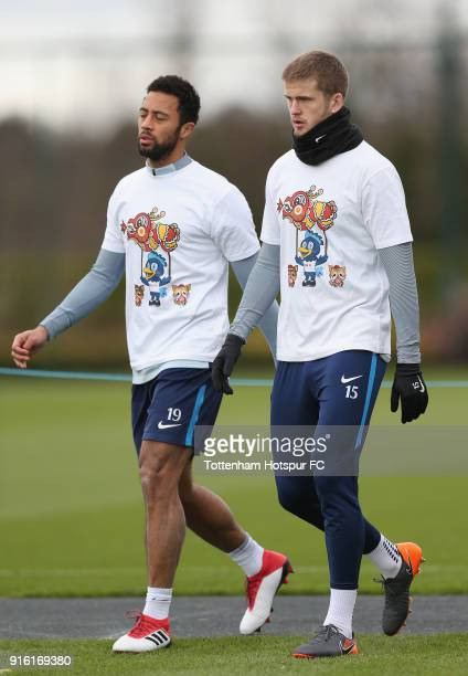 Mousa Dembele and Eric Dier of Tottenham Hotspur train in a Chinese New Year tshirt ahead of the north london derby during the Tottenham Hotspur...
