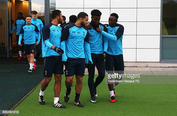Mousa Dembele Cameron CarterVickers Joshua Onomah and Victor Wanyama walk to the pitch during a Tottenham Hotspur training session at Tottenham...