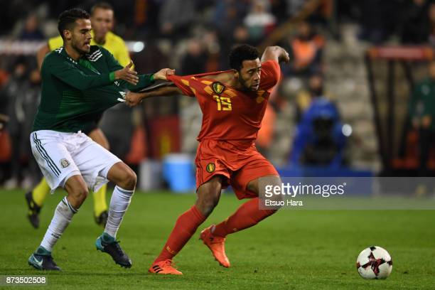 Mousa Dembele of Belgium and Diego Reyes of Mexico compete for the ball during the international friendly match between Belgium and Mexico at King...