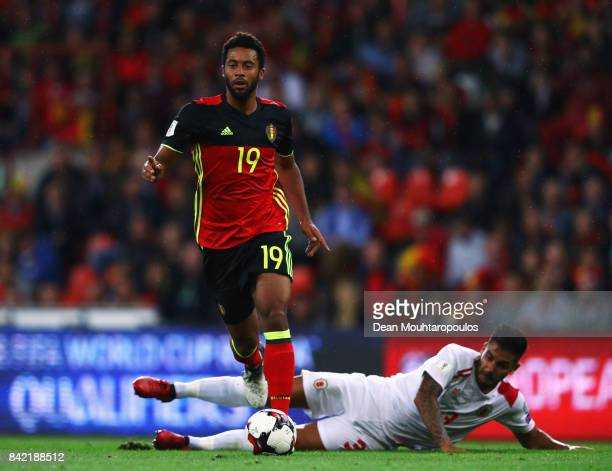 Mousa Dembele of Belgium gets past the tackle from Joseph Chipolina of Gibraltar during the FIFA 2018 World Cup Qualifier between Belgium and...