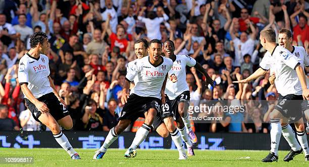 Mousa Dembele of Fulham celebrates after scoring his team's winning goal in the late stages of the Barclays Premier League match between Fulham and...