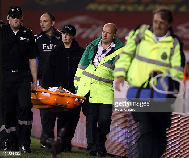Mousa Dembele of Fulham leaves the field injured during the Carling Cup 3rd Round tie between Stoke City and Fulham at the Britannia Stadium on...