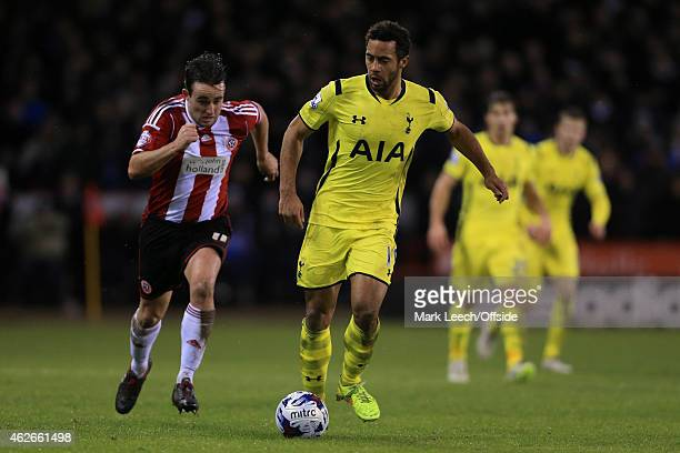 Mousa Dembele of Spurs battles with Jose Baxter of Sheff Utd during the Capital One Cup SemiFinal Second Leg match between Sheffield United and...