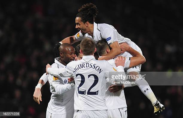 Mousa Dembele of Spurs celebrates his goal with team mates during the UEFA Europa League Round of 32 second leg match between Olympique Lyonnais and...