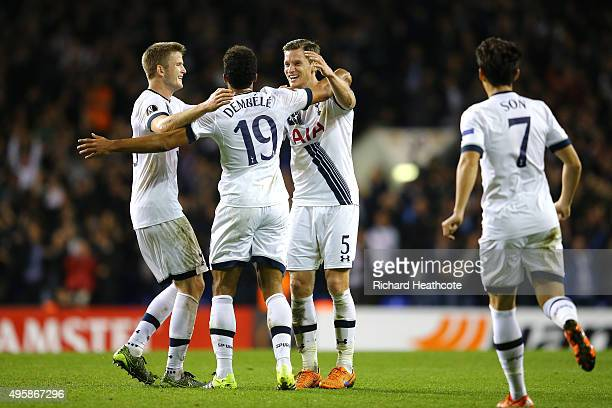 Mousa Dembele of Spurs celebrates with teammates Eric Dier and Jan Vertonghen of Spurs after scoring his team's second goal during the UEFA Europa...