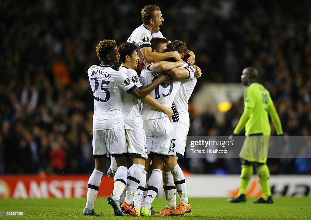 Mousa Dembele #19 (obscured) of Spurs is congratulated by teamates after scoring his team's second goal during the UEFA Europa League Group J match between Tottenham Hotspur FC and RSC Anderlecht at White Hart Lane on November 5, 2015 in London, United Kingdom.