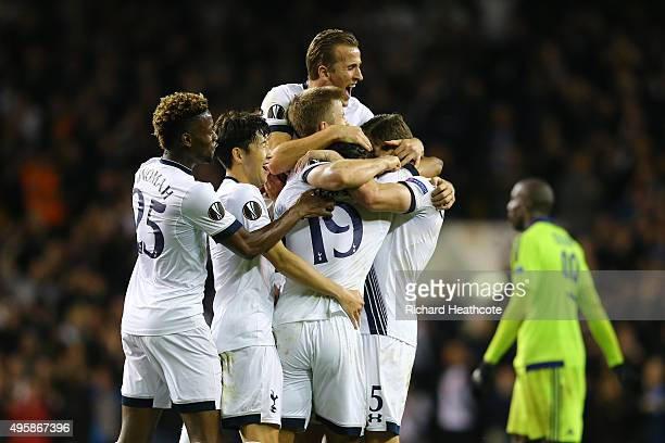 Mousa Dembele of Spurs is congratulated by teamates after scoring his team's second goal during the UEFA Europa League Group J match between...