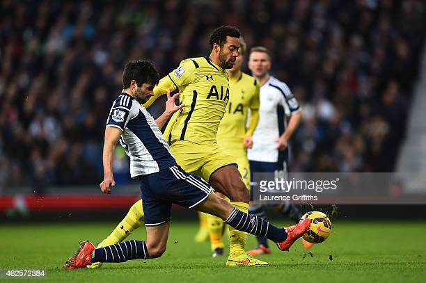 Mousa Dembele of Spurs is tackled by Claudio Yacob of West Brom during the Barclays Premier League match between West Bromwich Albion and Tottenham...