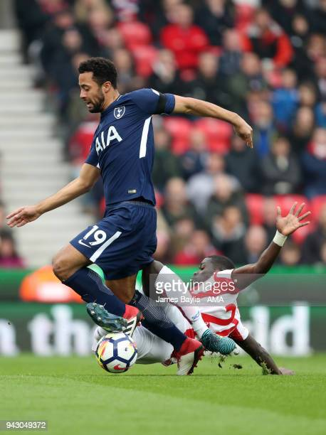 Mousa Dembele of Tottenham Hotspur and Badou Ndiaye of Stoke City during the Premier League match between Stoke City and Tottenham Hotspur at Bet365...
