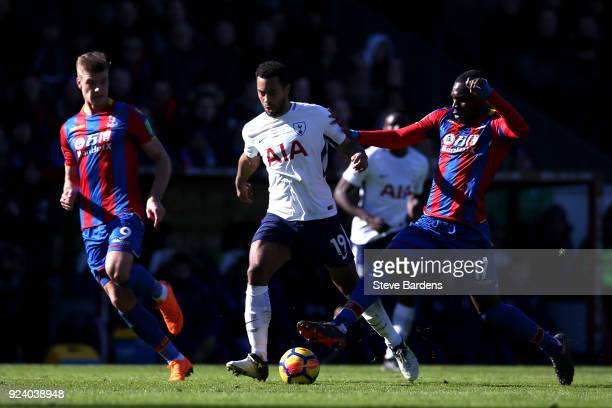 Mousa Dembele of Tottenham Hotspur and Christian Benteke of Crystal Palace compete for the ball during the Premier League match between Crystal...