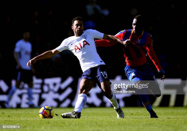 Mousa Dembele of Tottenham Hotspur and Christian Benteke of Crystal Palace in action during the Premier League match between Crystal Palace and...