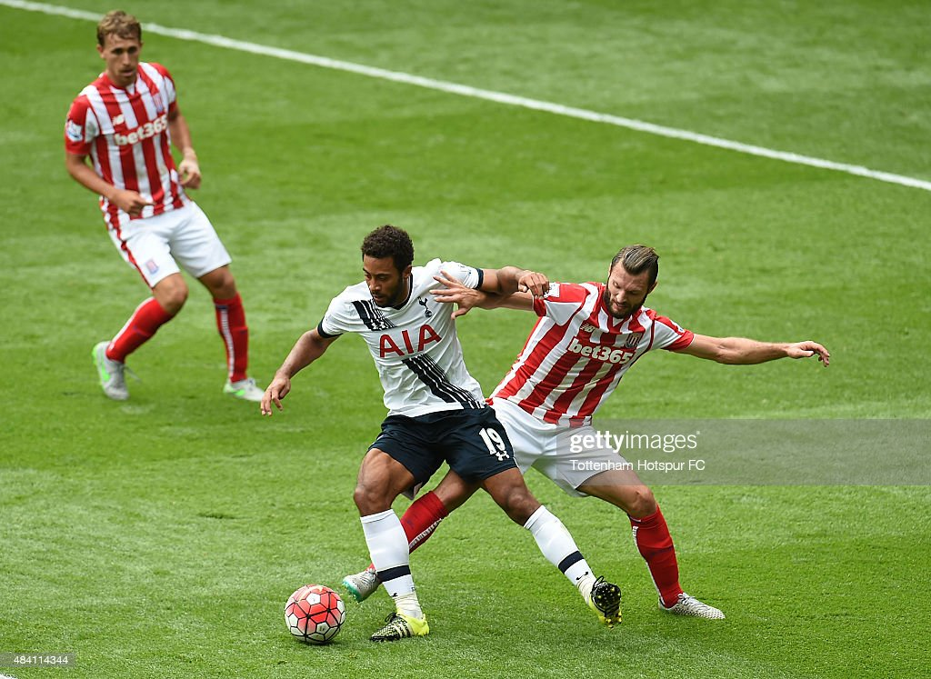 Mousa Dembele of Tottenham Hotspur and Erik Pieters of Stoke City in action during the Barclays Premier League match between Tottenham Hotspur and Stoke City at White Hart Lane on August 15, 2015 in London, United Kingdom.