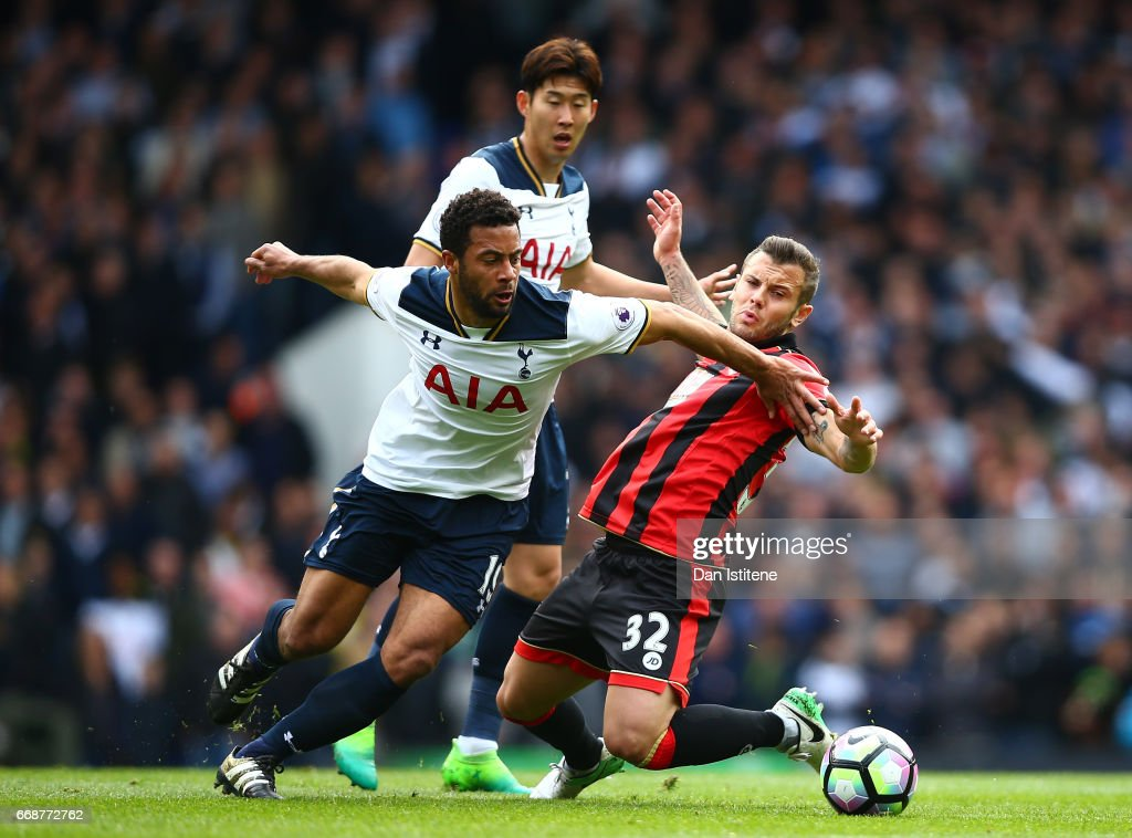 Mousa Dembele of Tottenham Hotspur and Jack Wilshere of AFC Bournemouth battle for possession during the Premier League match between Tottenham Hotspur and AFC Bournemouth at White Hart Lane on April 15, 2017 in London, England.