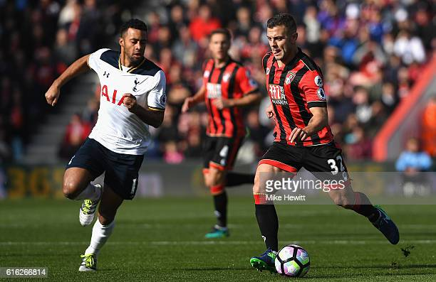 Mousa Dembele of Tottenham Hotspur and Jack Wilshere of AFC Bournemouth compete for the ball during the Premier League match between AFC Bournemouth...