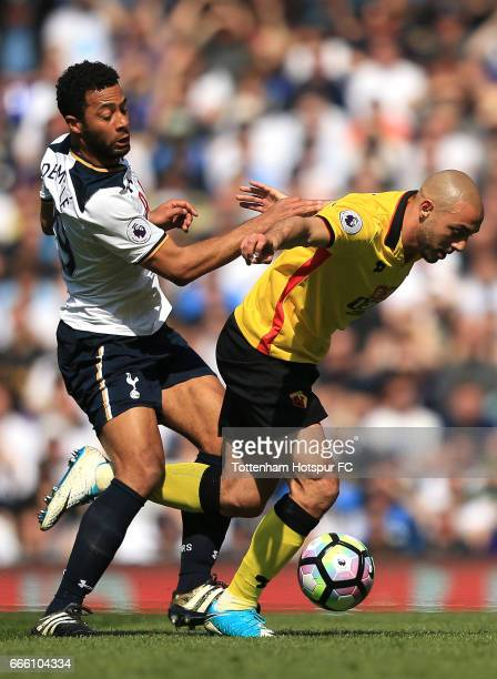 Mousa Dembele of Tottenham Hotspur and Nordin Amrabat of Watford battle for possession during the Premier League match between Tottenham Hotspur and...
