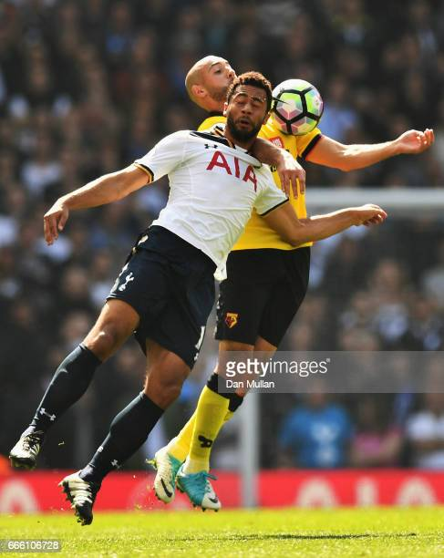 Mousa Dembele of Tottenham Hotspur and Nordin Amrabat of Watford battle to win a header during the Premier League match between Tottenham Hotspur and...