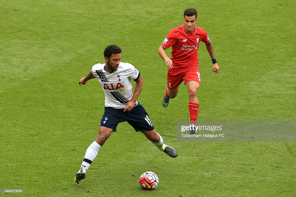 Mousa Dembele of Tottenham Hotspur and Philippe Coutinho of Liverpool compete for the ball during the Barclays Premier League match between Tottenham Hotspur and Liverpool at White Hart Lane Stadium on October 17, 2015 in London, England.
