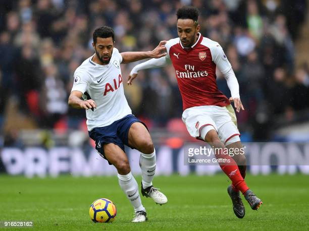 Mousa Dembele of Tottenham Hotspur and PierreEmerick Aubameyang of Arsenal battle for the ball during the Premier League match between Tottenham...