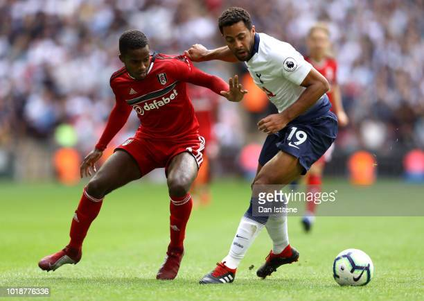 Mousa Dembele of Tottenham Hotspur and Ryan Sessegnon of Fulham battle for the ball during the Premier League match between Tottenham Hotspur and...
