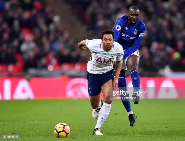Mousa Dembele of Tottenham Hotspur and Yannick Bolasie battle for the ball during the Premier League match between Tottenham Hotspur and Everton at...
