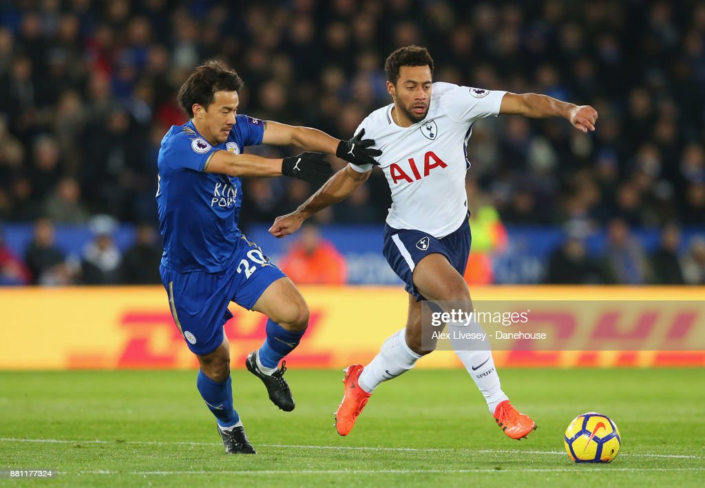 Mousa Dembele of Tottenham Hotspur beats Shinji Okazaki of Leicester City during the Premier League match between Leicester City and Tottenham Hotspur at The King Power Stadium on November 28, 2017 in Leicester, England.