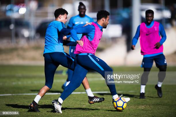 Mousa Dembele of Tottenham Hotspur conducts the ball under pressure from Dele Alli during a training session during day three of the Tottenham...
